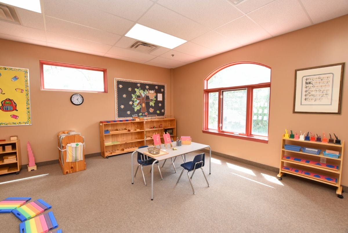 classroom corner with a table and bookshelf